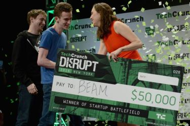 James Boehm and Matt Salsamendi accepting a check from Sam O'Keefe onstage during TechCrunch Disrupt NY 2016; photo by Noam Galai/Getty Images for TechCrunch