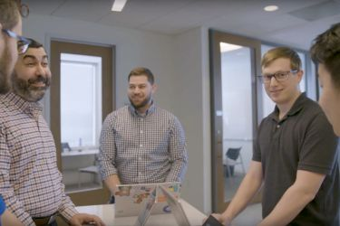 Photo of Microsoft employees talking