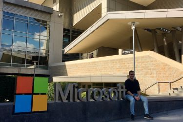 Photo of Elliot by Microsoft sign