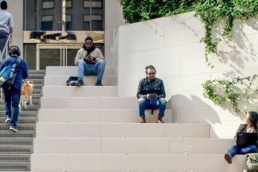 Photo of Microsoft employees sitting on building steps