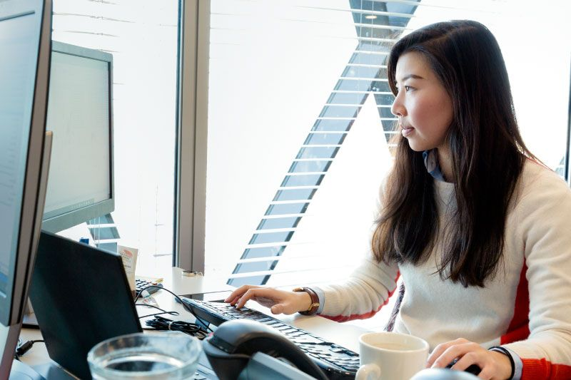Photo of woman working on computer
