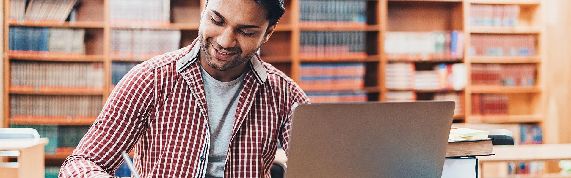Photo of University student working on laptop