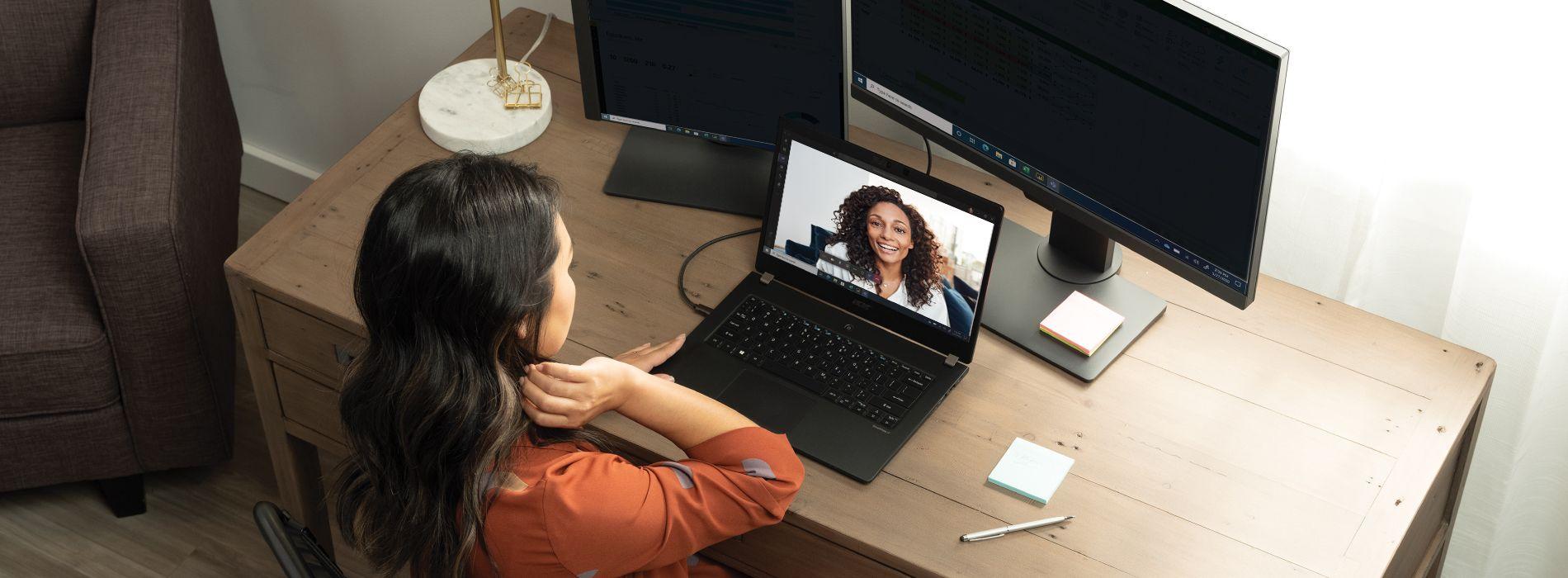 Photo of woman having meeting on laptop
