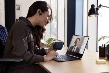 Photo of woman doing virtual meeting on laptop