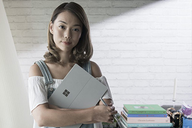 Fashion blogger, Andrea Chong, with Surface Pro 4