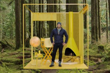 Photo of man in mock-up in forest