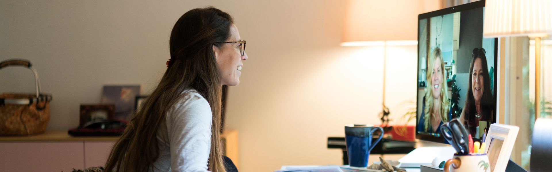 Photo of woman working at computer