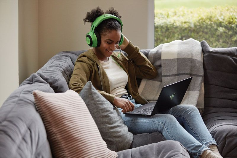 Photo of University student on couch with laptop