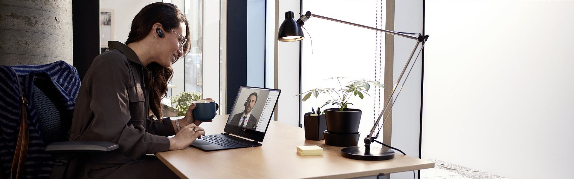 Photo of woman using laptop to video conference